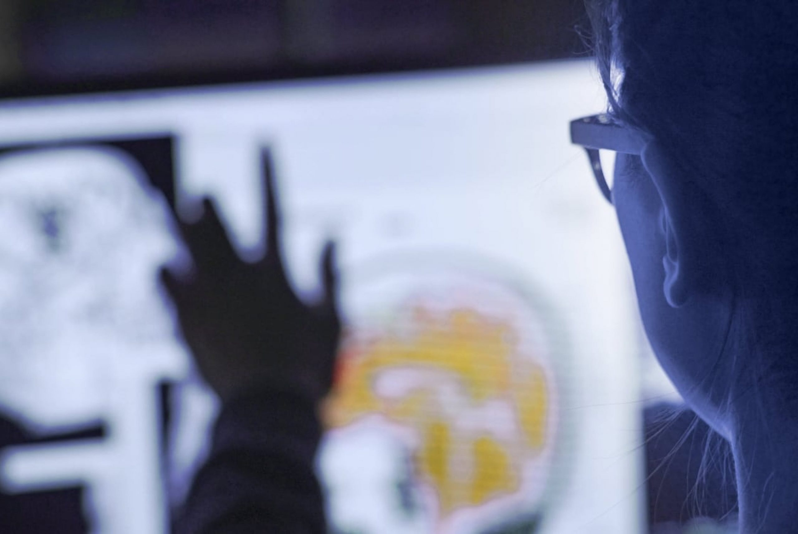 Man looking at data on screen